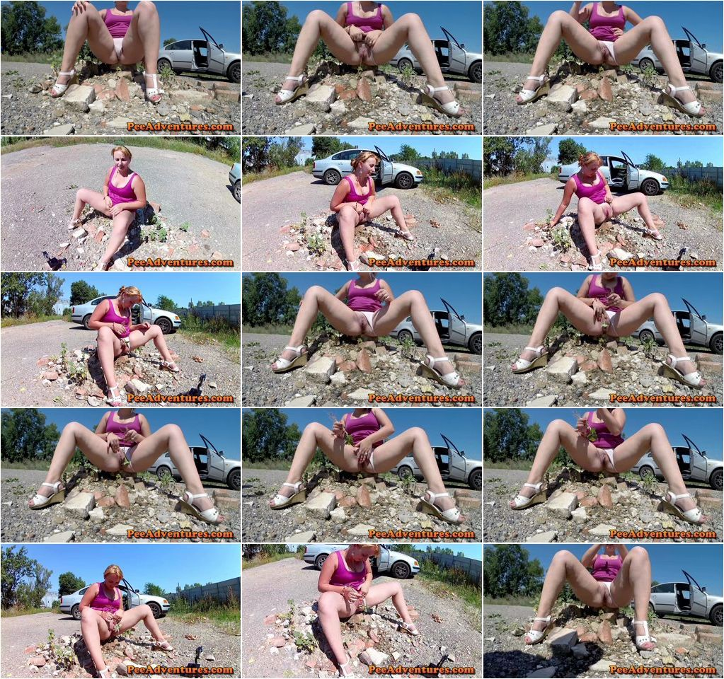 Pissing on a pile of rocks next to a car in a parking lot - Hard-Extreme.com.jpg